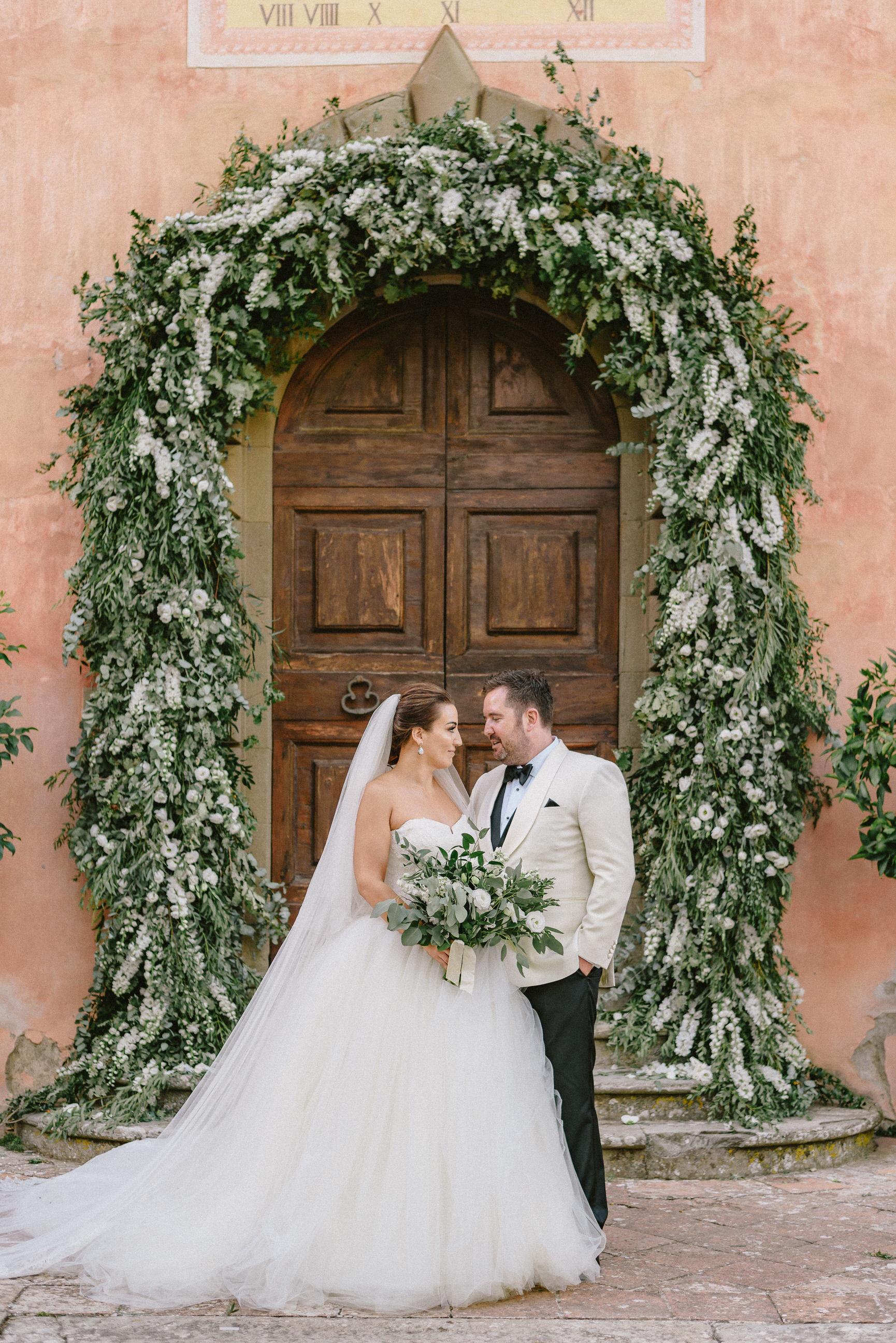 Luxury italy wedding planner Vignamaggio ceremony arch